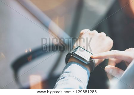 Closeup Photo Woman Relaxing Modern Loft Studio.Using Generic Design Smart Watch.Female Hands Touching Screen Smartwatch.Manage Free Time Process. Horizontal mockup. Burred background. Film effects.