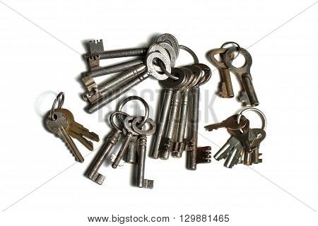 many old keys on keyrings on white background