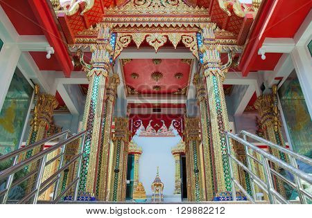 The colorful entrance of sermon hall in a monastery at thailand