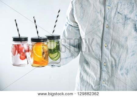 Unrecognizable Man Offers Jars With Cold Fresh Beverages To Cool Down In Summer Time. Healthy Drinks