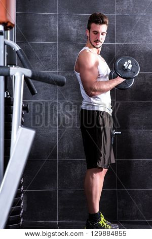 Handsome, young man working out in the gym