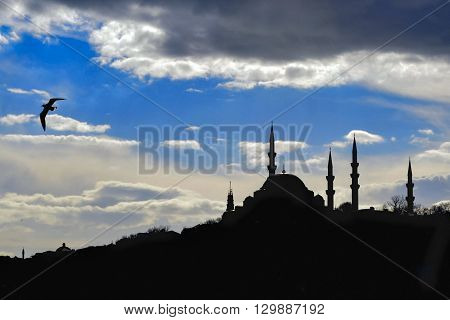 Istanbul Suleymaniye mosque silhouette light play of sun and cloud shadow skyline. Kanuni Sultan Süleyman mosque.