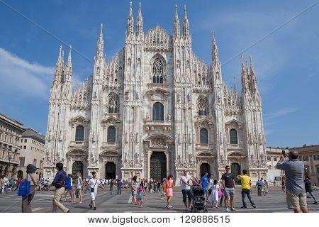 Milan, Italy - Circa August 2013: People walking on Piazza de Duomo in front of Duomo di Milano.