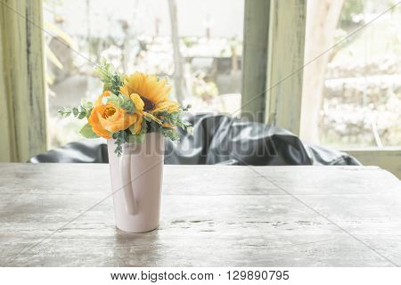 Vase of flowers on table Artificial Flower Vase.