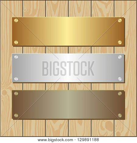 golden silver and bronze plaques on wooden background