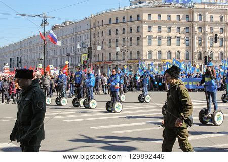 St. Petersburg, Russia - 1 May: People on the electric scooters in the May Day demonstration, 1 May, 2016. Day festive demonstration on the Nevsky Prospect in St. Petersburg, the first of May.