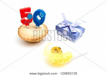 Cupcake With Fifty Years Birthday Candle, Gift And Whistle On White