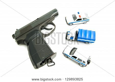 Gun And Police Cars On White