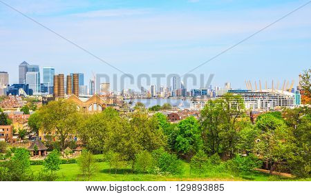 London UK - May 9 2016 - Panoramic view of London cityscape from Greenwich Hill featuring Canary Wharf Greenwich Power Station river Thames and the O2 Arena