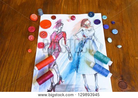 composition drawing threads button thimble on a wooden background