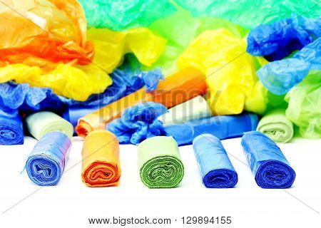A lot of a colorful garbage bags rolls
