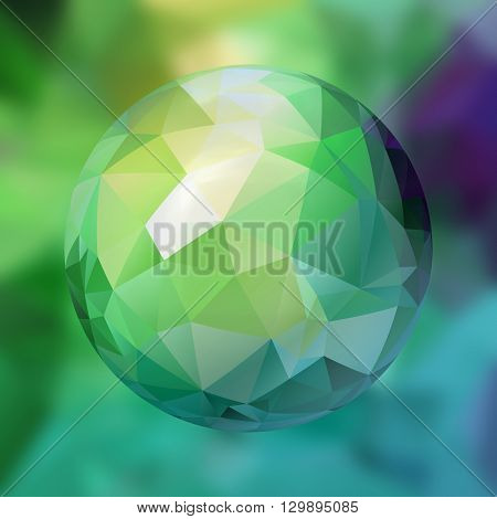 glass sphere with polygon pattern on blurred background - blue and green colored