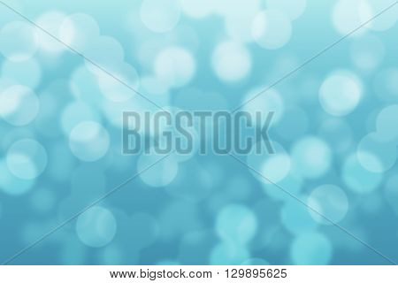 Abstract circular light blue turquoise light bokeh background