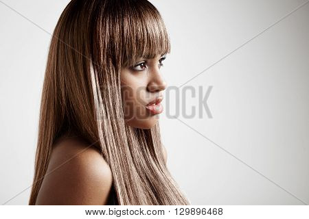 Black Woman With A Brunette Long Hair