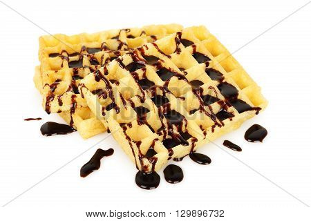 waffles with chocolate syrup isolated on white