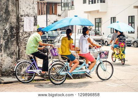 People On Double Bicycle, George Town