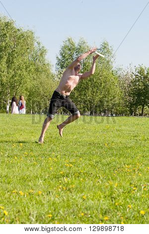 Sankt-Petereburg, Russia - May 15 2016: the man plays in park a plate. In St. Petersburg in parks many people play active games
