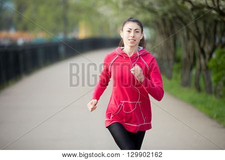 Attractive Woman Enjoying Jogging Outdoors
