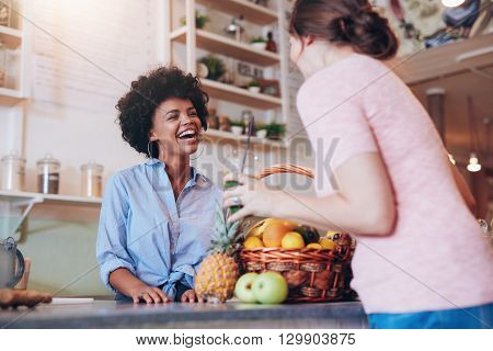 Juice Bar Owner Talking To Female Customer