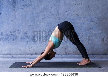 Young woman practicing yoga.