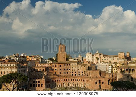 Big clouds over the ancient Trajan Market Rome Italy