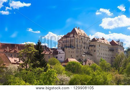 Old castle with blue background and green vegetaion