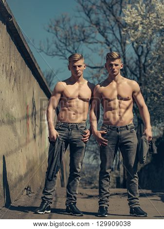 Muscular Bare-chested Young Twin Men