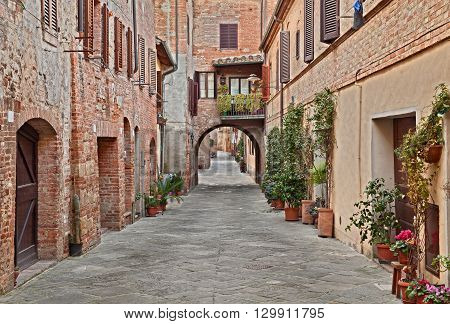 picturesque narrow street in the historic center of the village Buonconvento in Siena, Tuscany, Italy