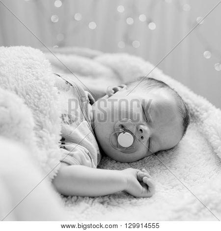 Sleeping Newborn With Pacifier