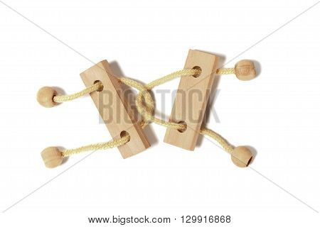 Wooden puzzle with shadow on white background
