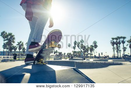 Skater boy ready to performing tricks at the skate park