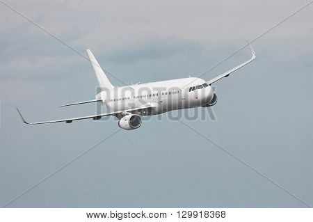 Commercial aircraft flying in the clouds