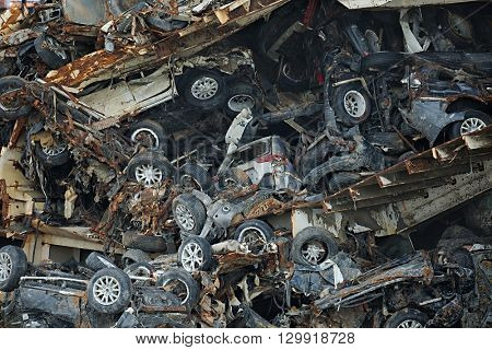 Wrecked car reamains in a big pile