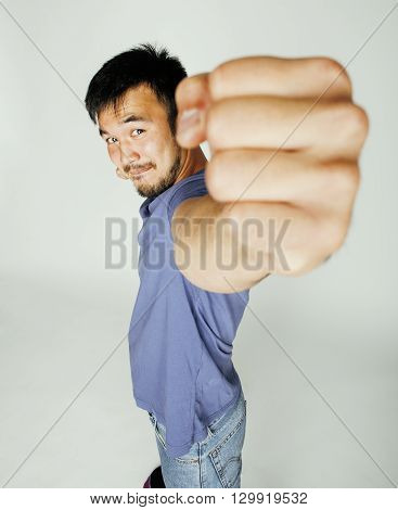 young cute asian man on white background gesturing emotional, pointing, smiling, lifestyle people concept, cheerfull mature guy