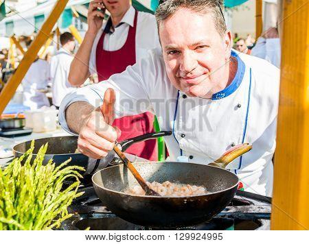 Ljubljana, Slovenia - May 6: Chef approving a dish at Odprta kuhna, Open kitchen event, on May 6 2016 in Ljubljana, Slovenia.