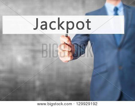 Jackpot - Businessman Hand Holding Sign