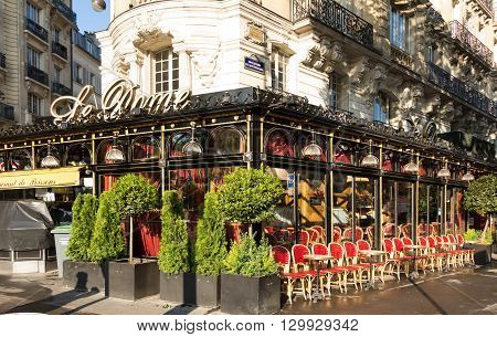 Paris France-May 16 2016 : The cafe Le Dome is the famous cafe in the Montparnasse quarter of Paris.It had been frequented by Pablo Picasso Amadeo Modigliani Wassilii Kandinsky...