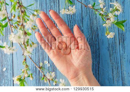 Beautiful set of wedding rings in woman hand