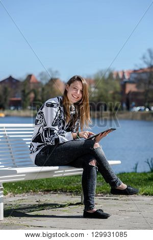 Laughing Woman With A Tablet Computer