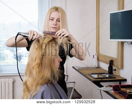 Barber Straightening Client's  Hair