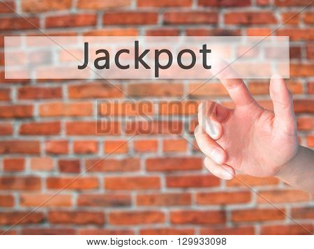 Jackpot - Hand Pressing A Button On Blurred Background Concept On Visual Screen.