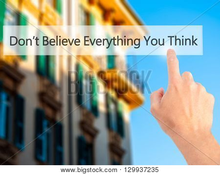 Don't Believe Everything You Think - Hand Pressing A Button On Blurred Background Concept On Visual
