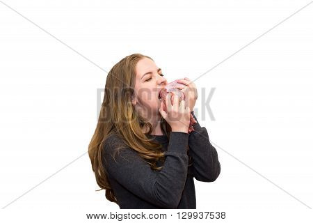 Girl eating a piece of fresh meat