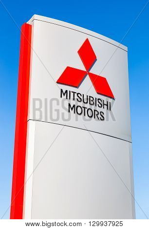 SAMARA RUSSIA - MAY 14 2016: Official dealership sign of Mitsubishi against the blue sky. Mitsubishi Motors Corporation is a Japanese automotive manufacturer