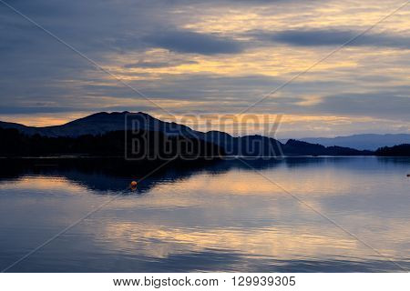Calm and tranquil sunrise Loch Lomond Scotland