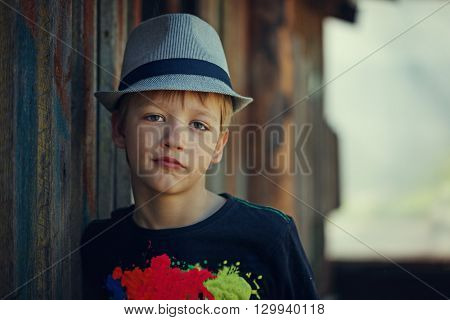 Young attractive boy wearing a hat looking at the camera