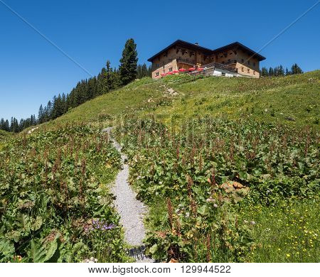 SCHROECKEN AUSTRIA JUNE 30: A view of Berghotel Koerbersee at the top of hill near village Schroecken in Bregenzerwald region Vorarlberg in Austria 2015.