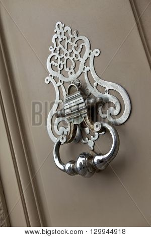 Bronze knocker on the door of a French mansion