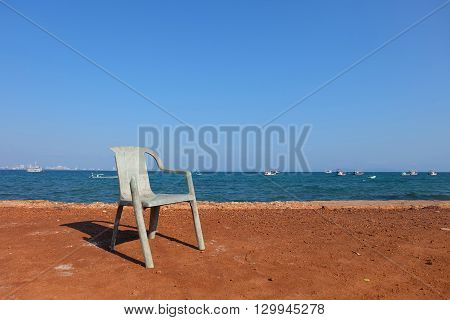 a beautiful chair in front of a nice and relax sea beach view. I took it on my vacation. Love the color of it.