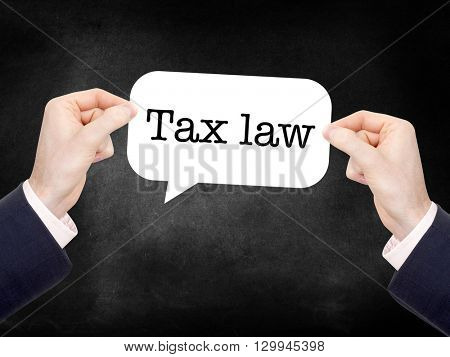 Tax law written on a speechbubble